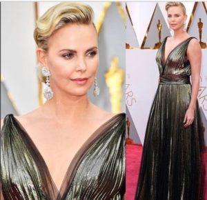 fc74864248b8 Charlize Theron Look  in abito Dior e orecchini enormi agli Oscar ...